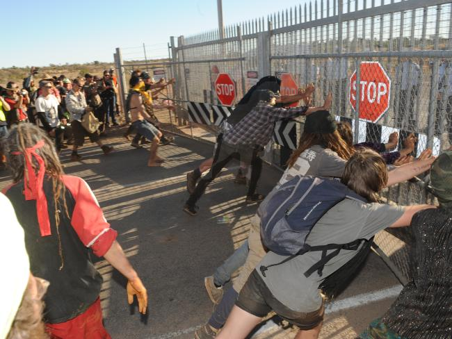 'Lizard's Revenge' protesters force open one of the Olympic Dam's outer gates in 2012.